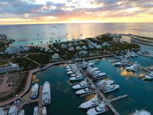 Aerial shot of Chub Cay Resort & Marina, including clubhouse, cabanas, villas, dock slips, and Sunset Beach.